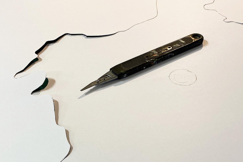 Arbeitsprozess   Cuttern einer Papierschablone zum Druck
